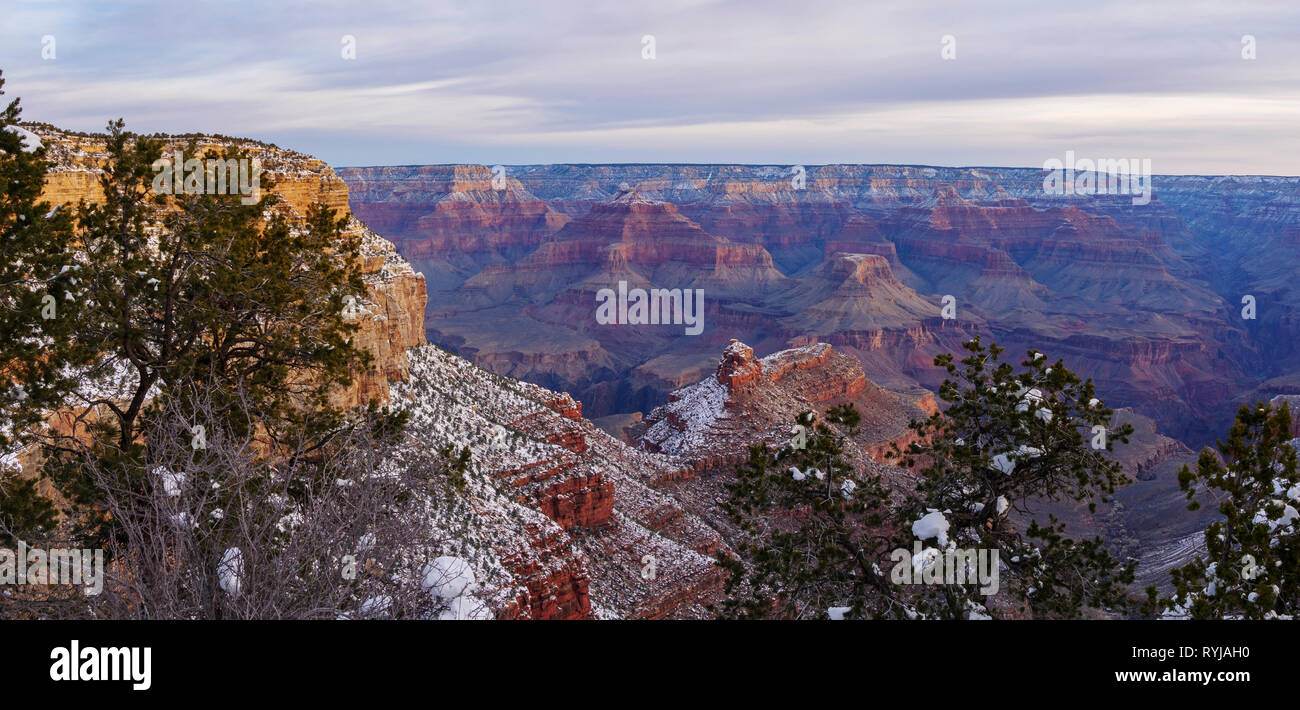 Morning panorama of the Grand Canyon. The Battleship is at center with Cheops Pyramid, Isis Temple and Shiva Temple from right to left beyond it. - Stock Image