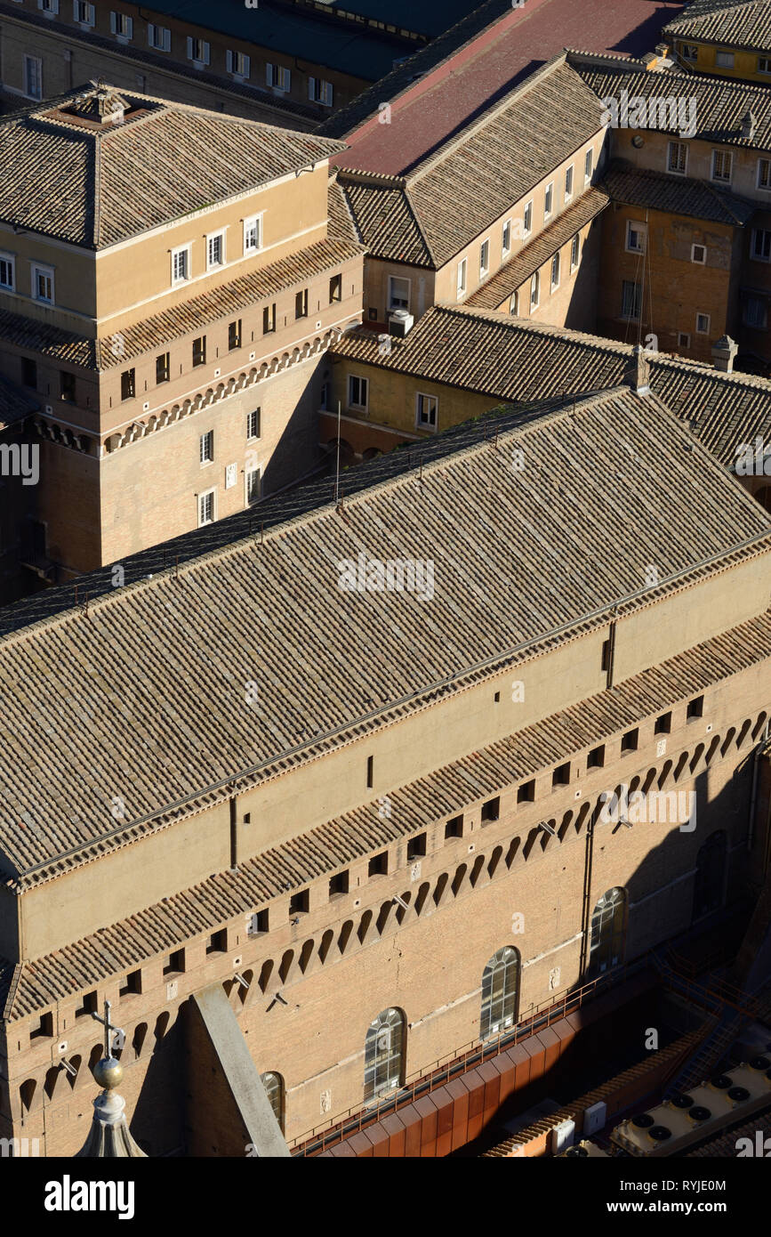 Aerial View over the Rooftops of the Vatican Museums taken from the Viewing Platform Around the Dome of Saint Perters Basilica Rome Italy - Stock Image