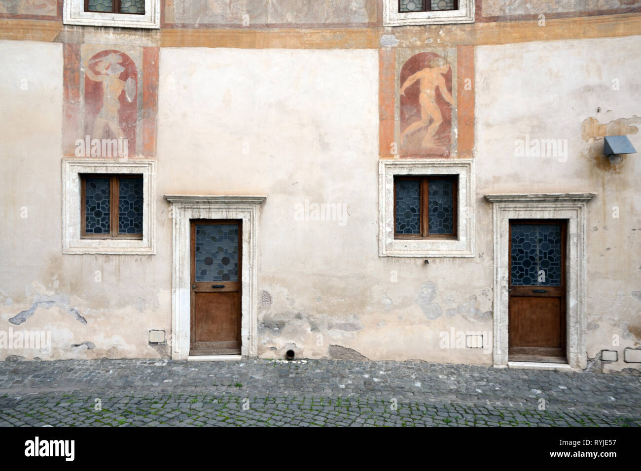 Small Terraced House Facade and Front Door in Interior Courtyard of Hadrian's Mausoleum (123-139AD) or Castel Sant'Angelo Rome Italy Stock Photo