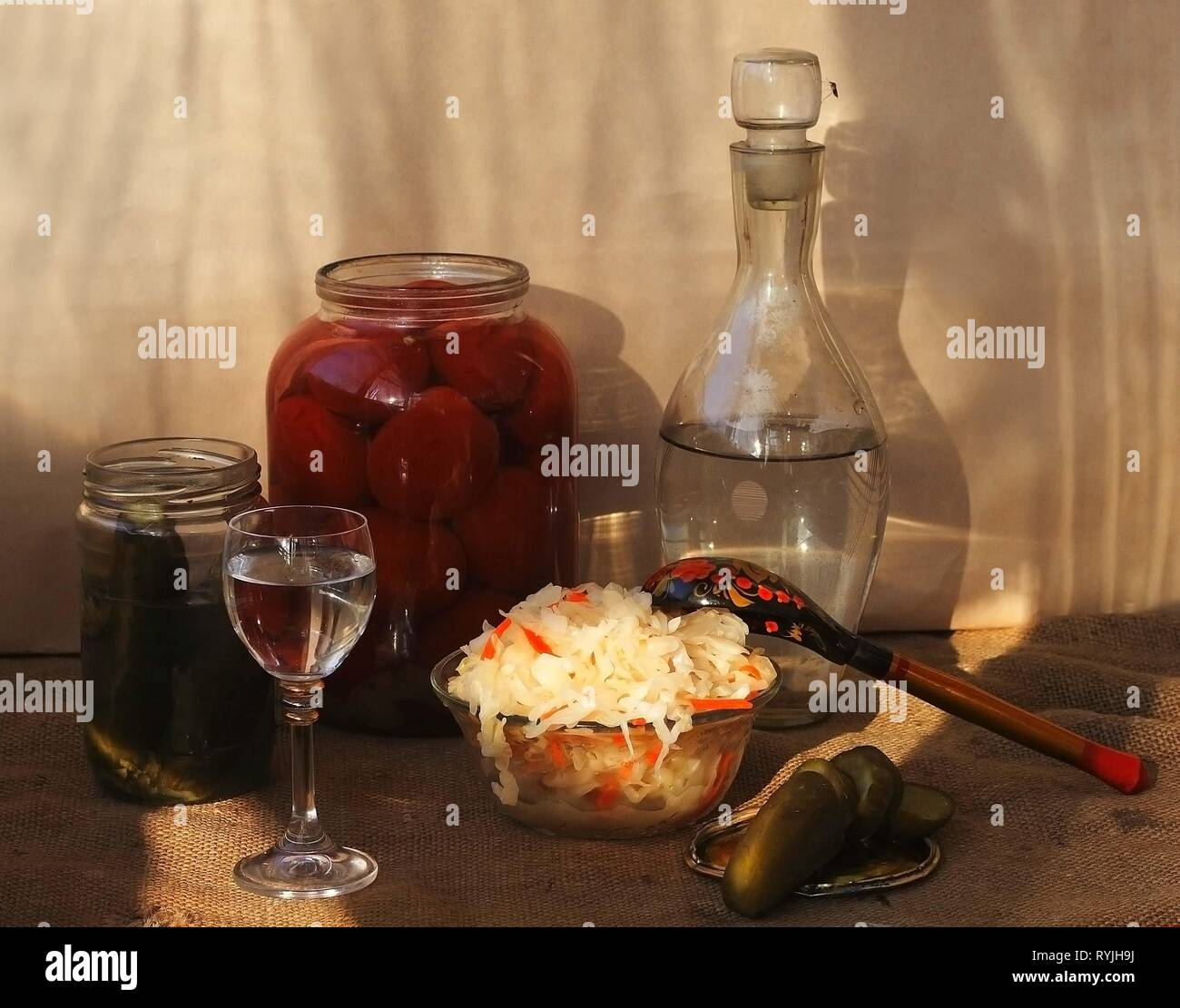 Cabbage with pickled cucumbers and moonshine - Stock Image