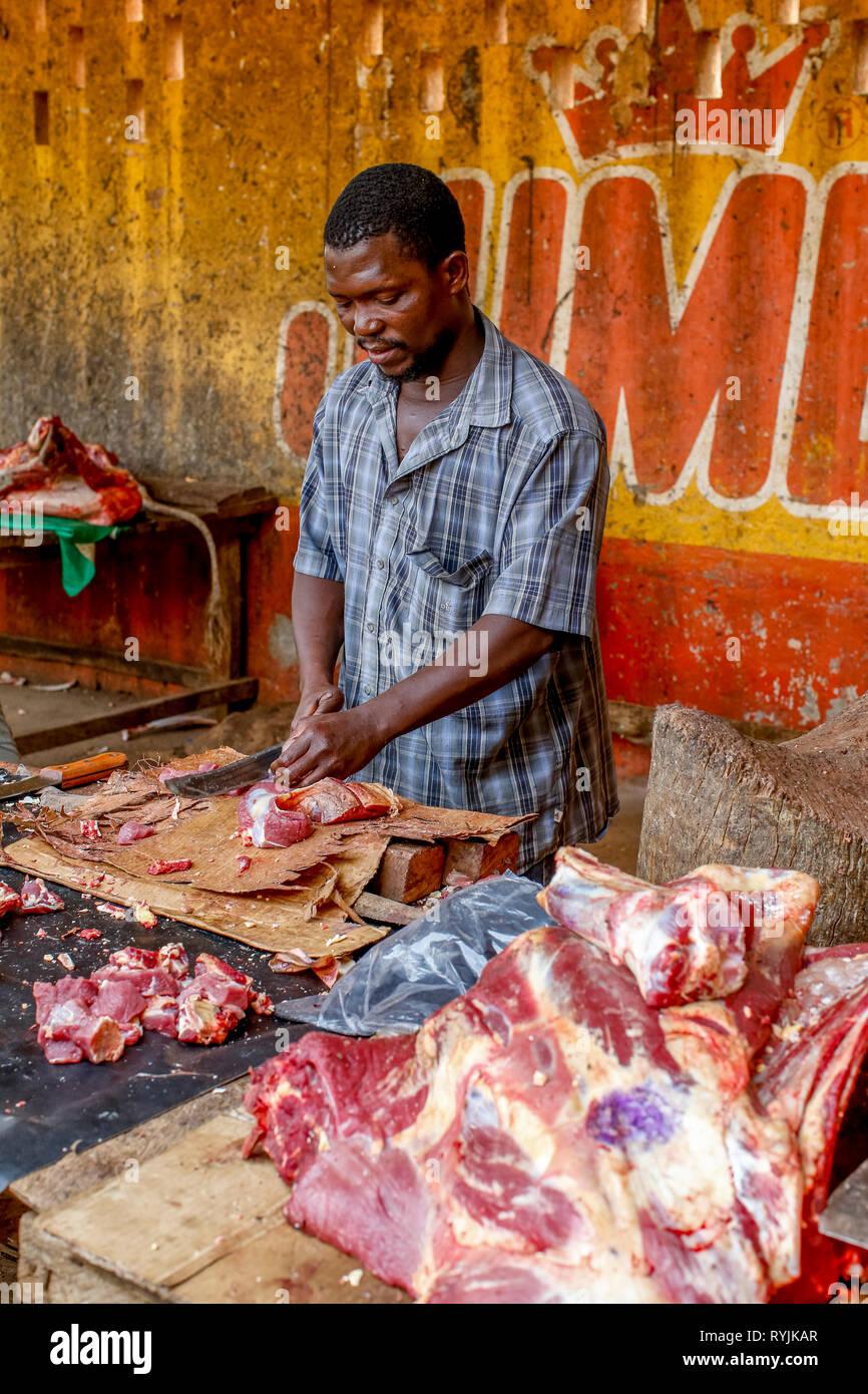 Butcher at Tenkodogo market, Burkina Faso. - Stock Image