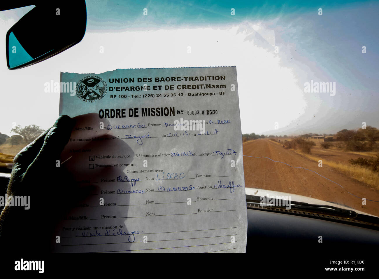 Document for traveling on an unsafe road in Burkina Faso. - Stock Image