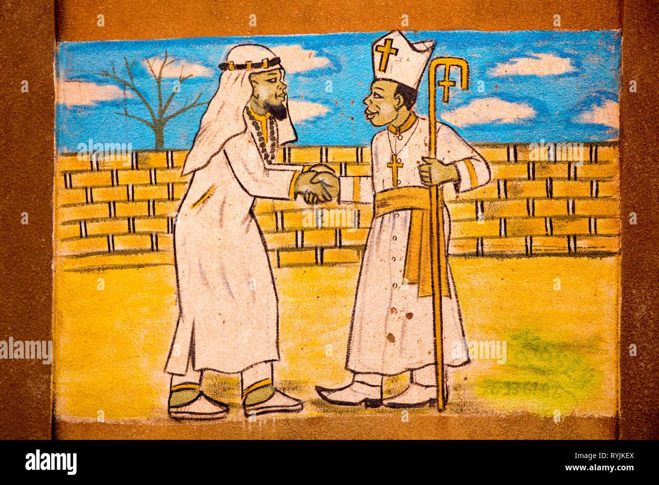 Wall painting advocating religious tolerance in Ouahigouya, Burkina Faso. - Stock Image
