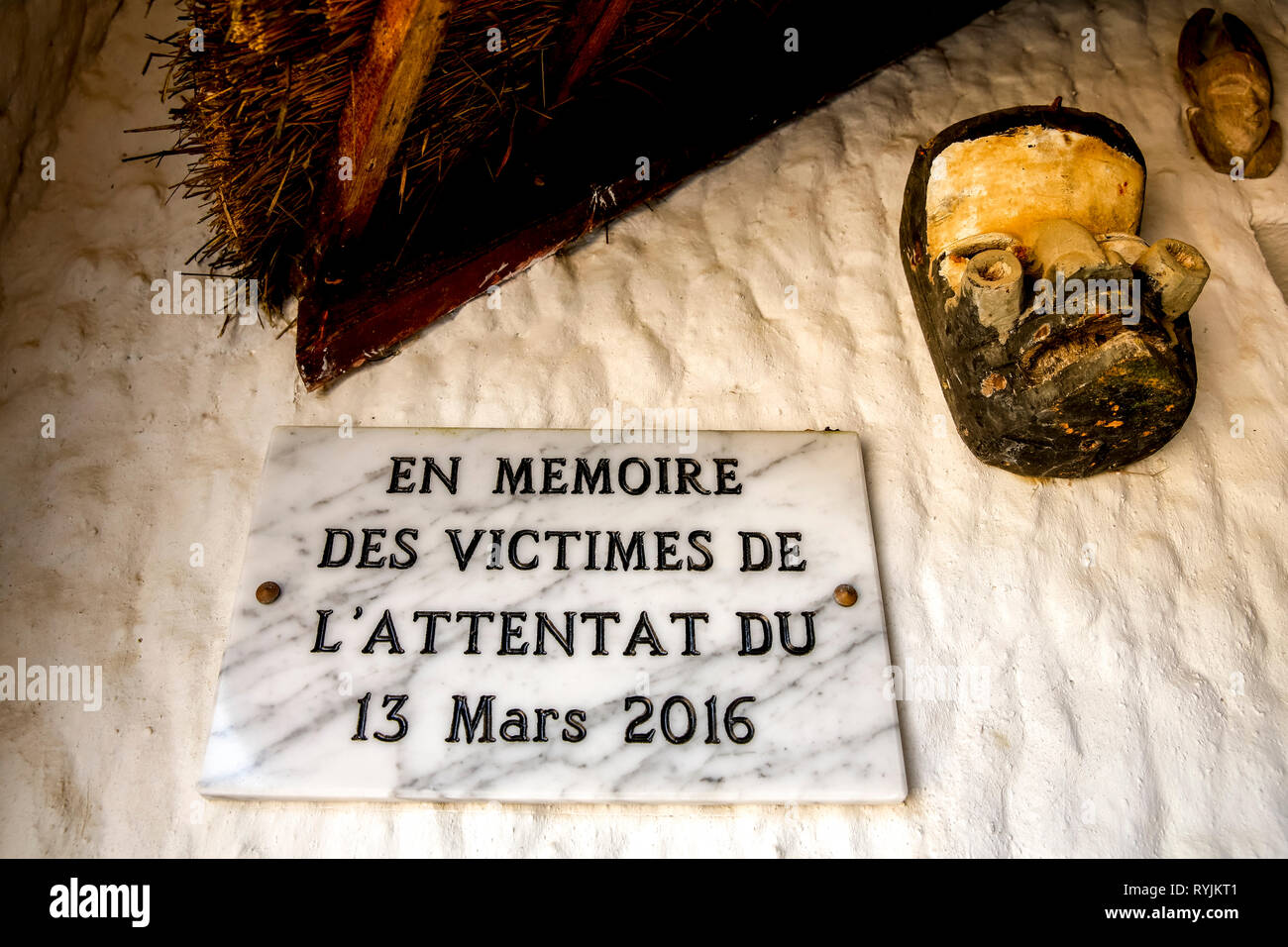 Memorial slab to the victims of terrorism in a Grand Bassam hotel, Ivory Coast. - Stock Image