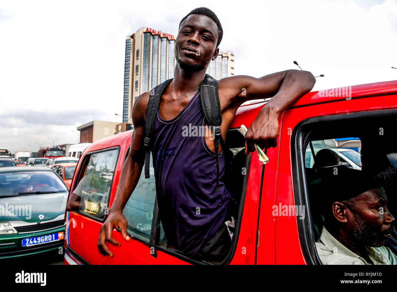 Public transport fare collector in Abidjan, Ivory Coast - Stock Image