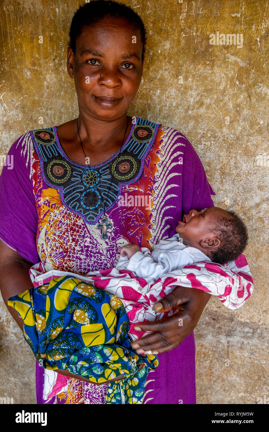 Mother holding baby near Agboville, Ivory Coast. Stock Photo