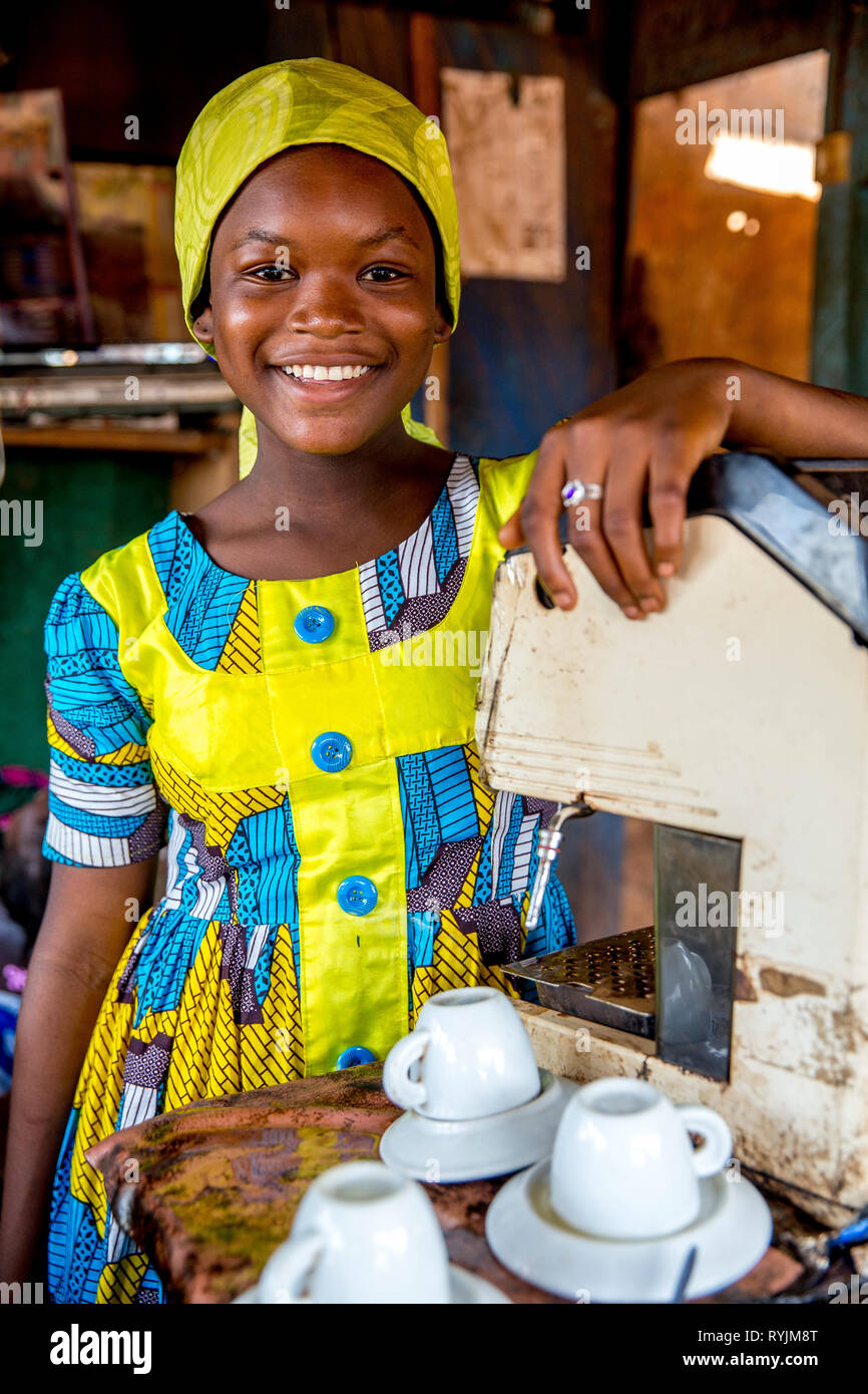 Smiling muslim girl working in a café near Agboville, Ivory Coast. Stock Photo