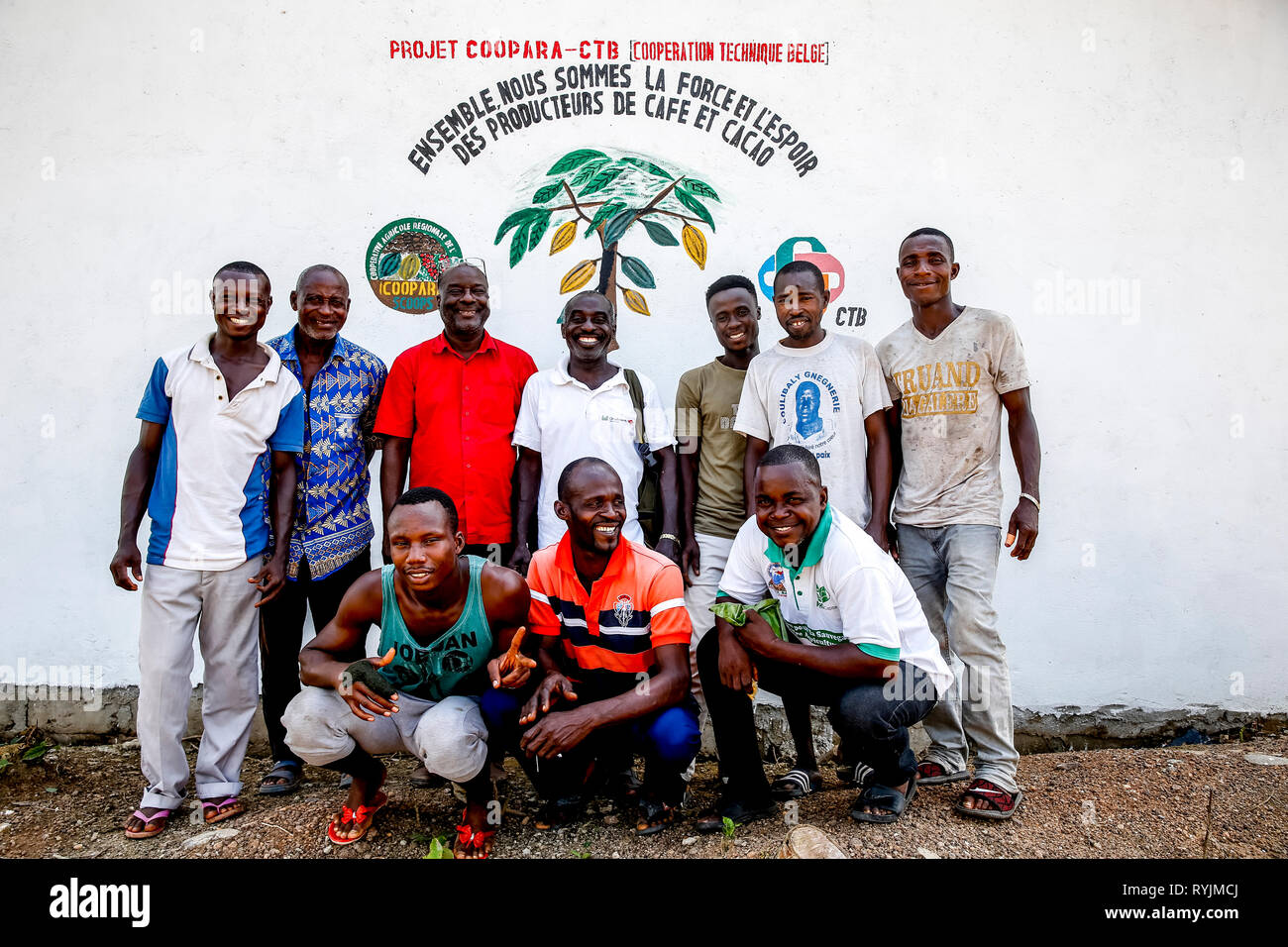 Cocoa planters' cooperative members in a village near Agboville, Ivory Coast. - Stock Image
