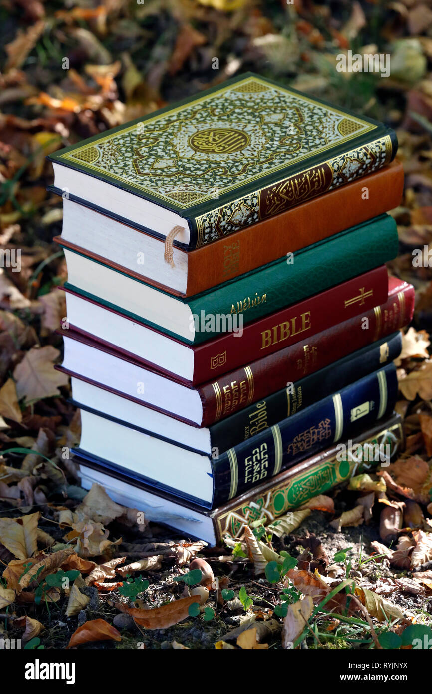 The three monotheistic religions.  Christianity,  Islam and judaism.  Thorah, Quran and Bible. Interreligious symbols. - Stock Image