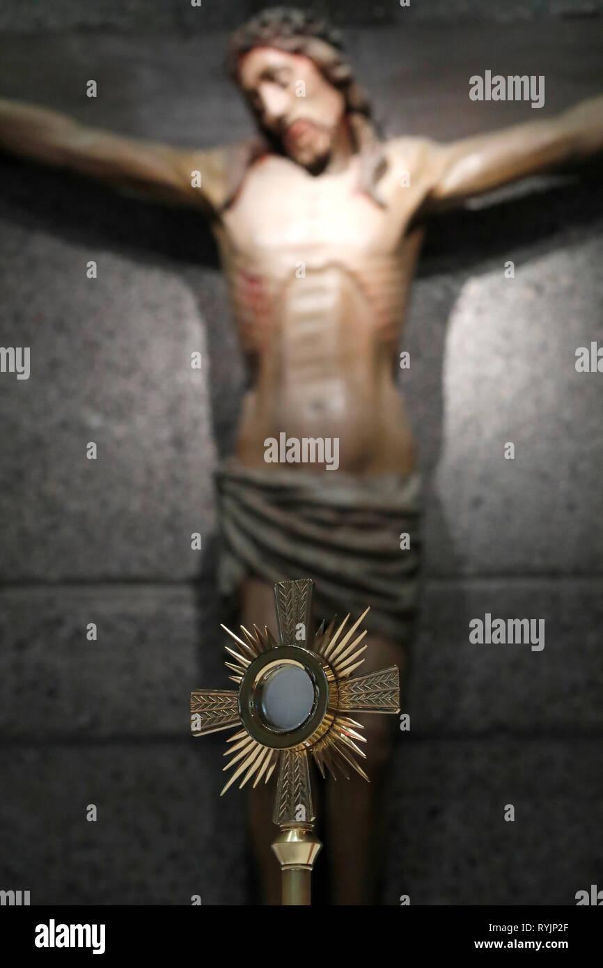 Monstrance and jesus statue.  Eucharistic adoration. France. - Stock Image