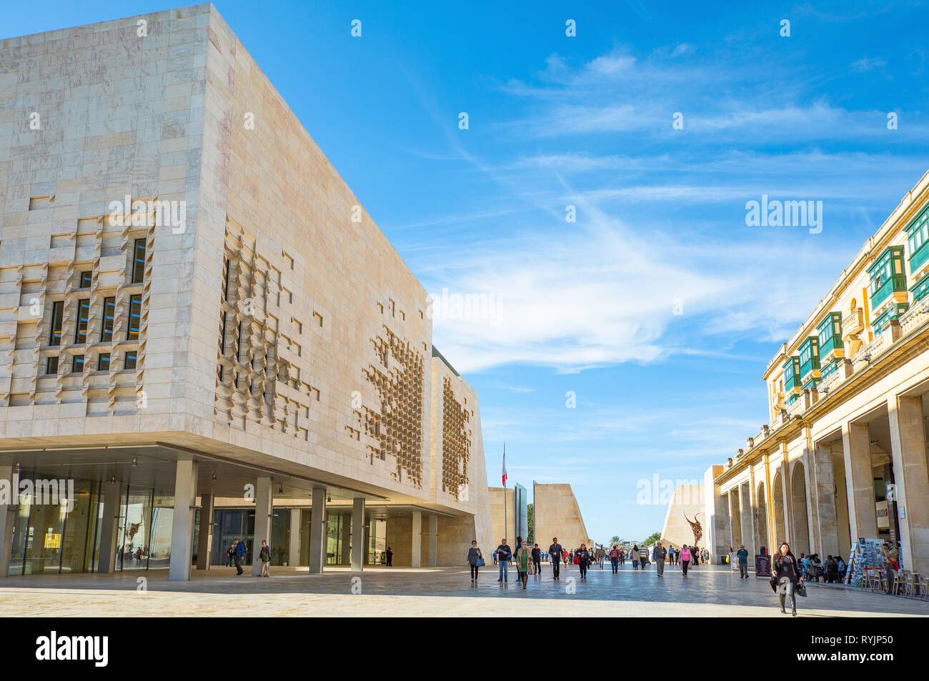 Malta, Valletta, People in the Republic square with the new Parliament Building on the left - Stock Image