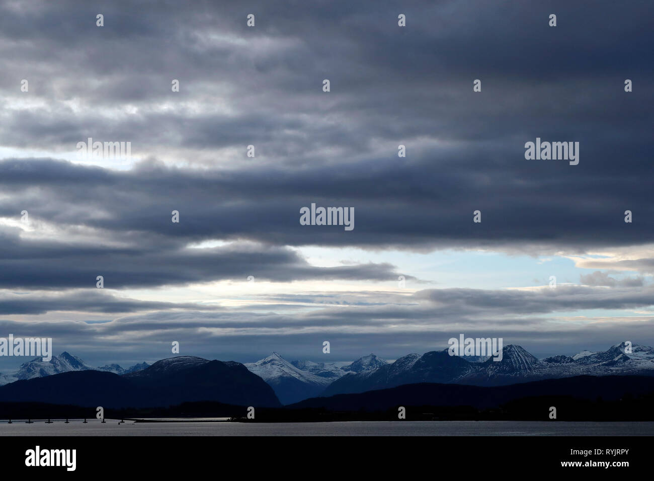 Cloudy sky over lake and mountains.  Molde. Norway. - Stock Image
