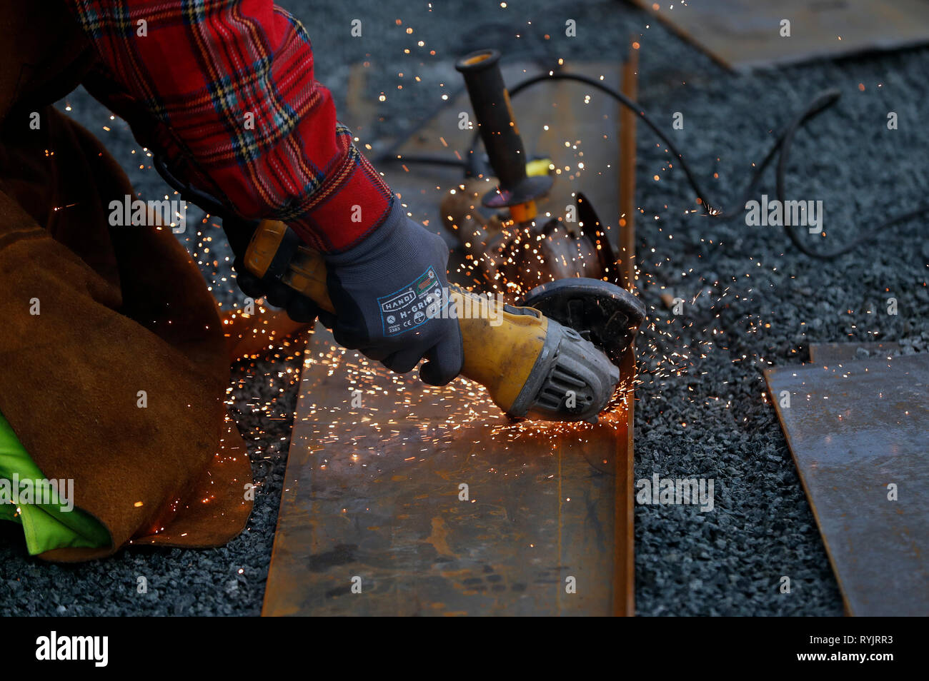 Construction worker working on construction site. Circular saw.  Trondheim. Norway. Stock Photo