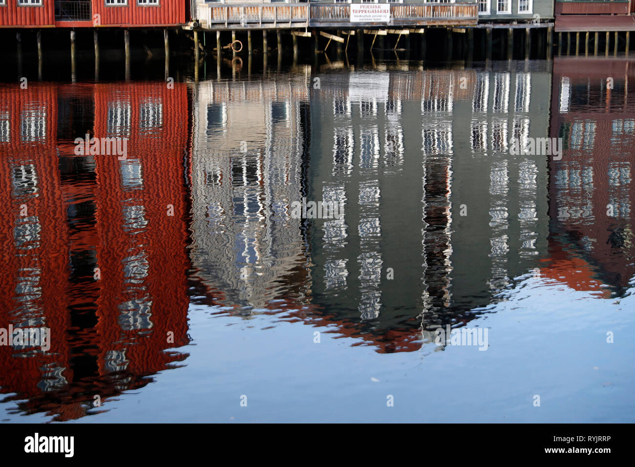 Restored and converted storehouses along the River Nidelva. Trondheim. Norway. - Stock Image