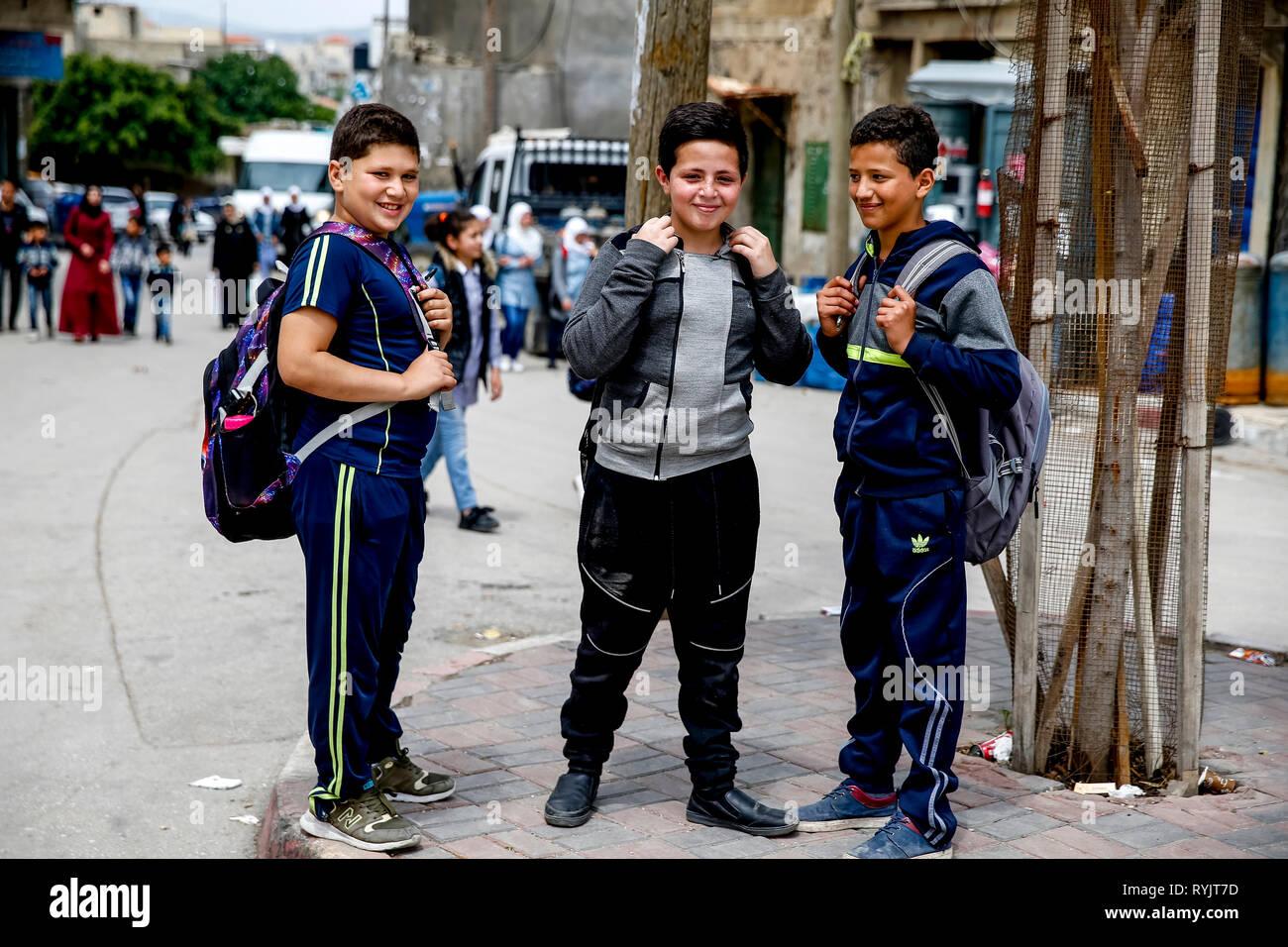Palestinian schoolchildren standing in a street of Beit Furik, West Bank, palestine. - Stock Image