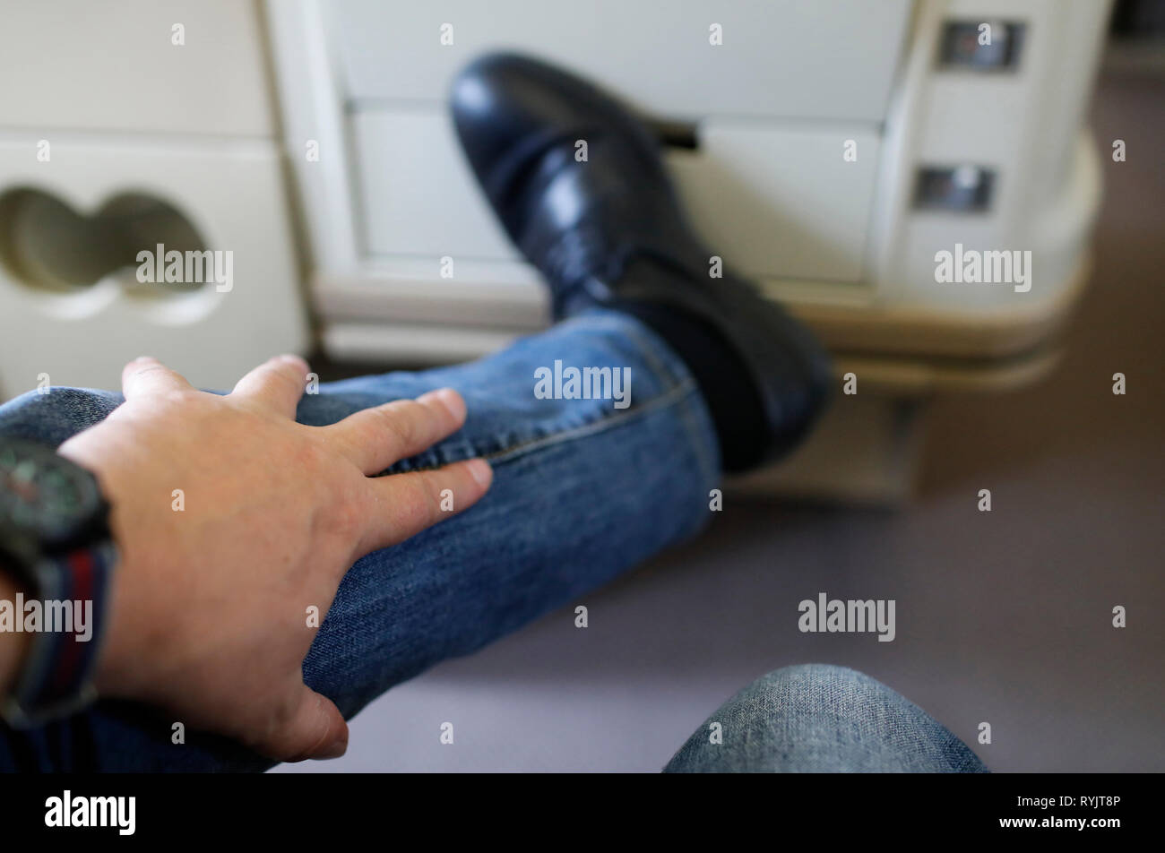 Airplane. Phlebitis. Traveling more than eight hours by palne could be at risk for blood clots. Singapore. - Stock Image