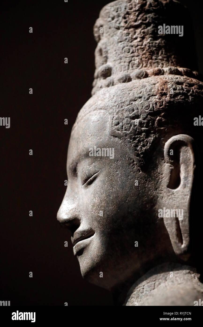 Asian Civilisations Museum. Angkor. Exploring Cambodia's sacred city.  Cosmic radiating Lokeshvara. Cambodia, 12th century. Sandstone. Singapore. - Stock Image