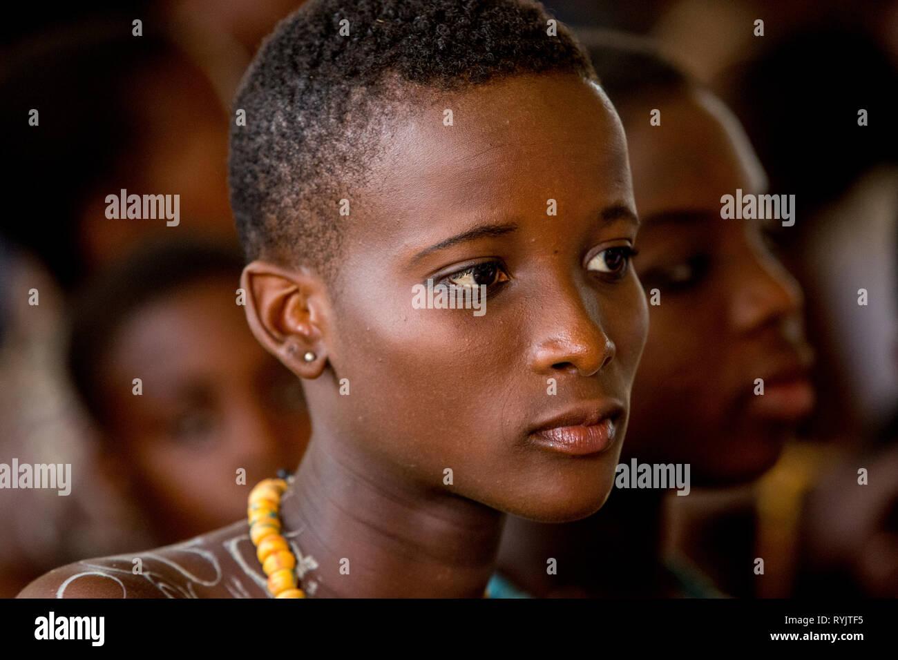 Teenager attending mass in Cristo Risorto de Hedzranawoe catholic parish church, Lomé, Togo. - Stock Image