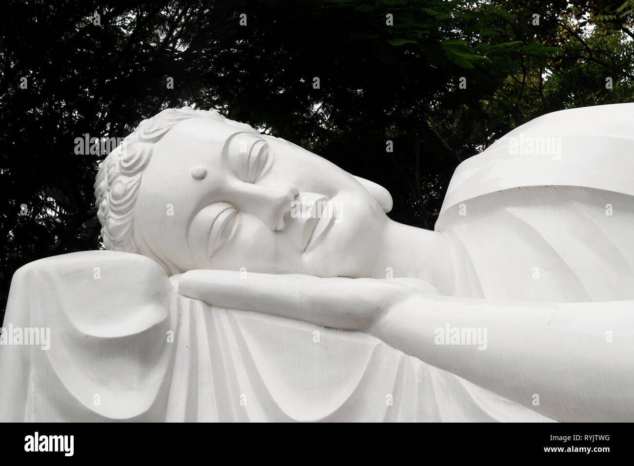Ho Phap buddhist temple.  The final Nirvana. The Buddha entered into meditation, deeper and deeper. And then he passed away.   Vung Tau. Vietnam. - Stock Image