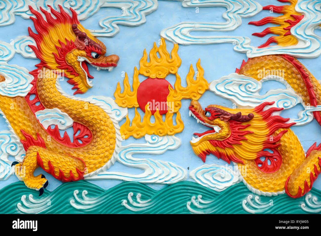 Huynh Dao buddhist pagoda.  Chinese dragon traditionally symbolize potent and auspicious powers. Sculpture.  Chau Doc. Vietnam. - Stock Image