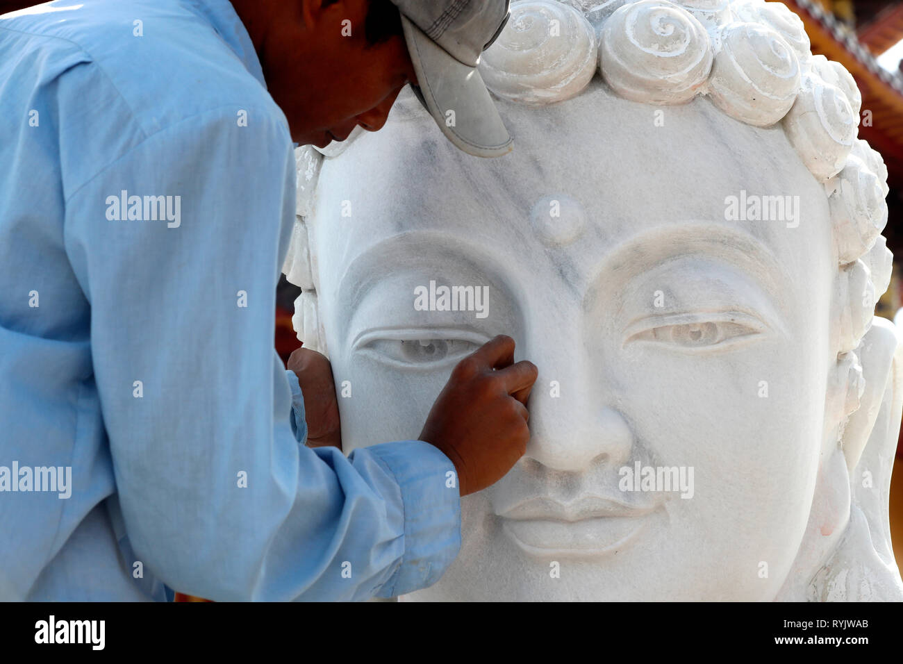 Phat Ngoc Xa Loi Buddhist temple.  An artisan carves a Buddha statue at a marble  workshop. Can Tho. Vietnam. - Stock Image