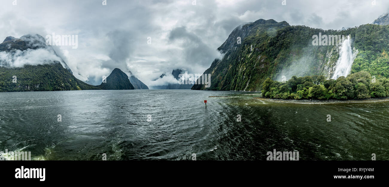 Cloudy and rainy day at amazing and vibrant Milford Sound, South Island, New Zealand - Stock Image