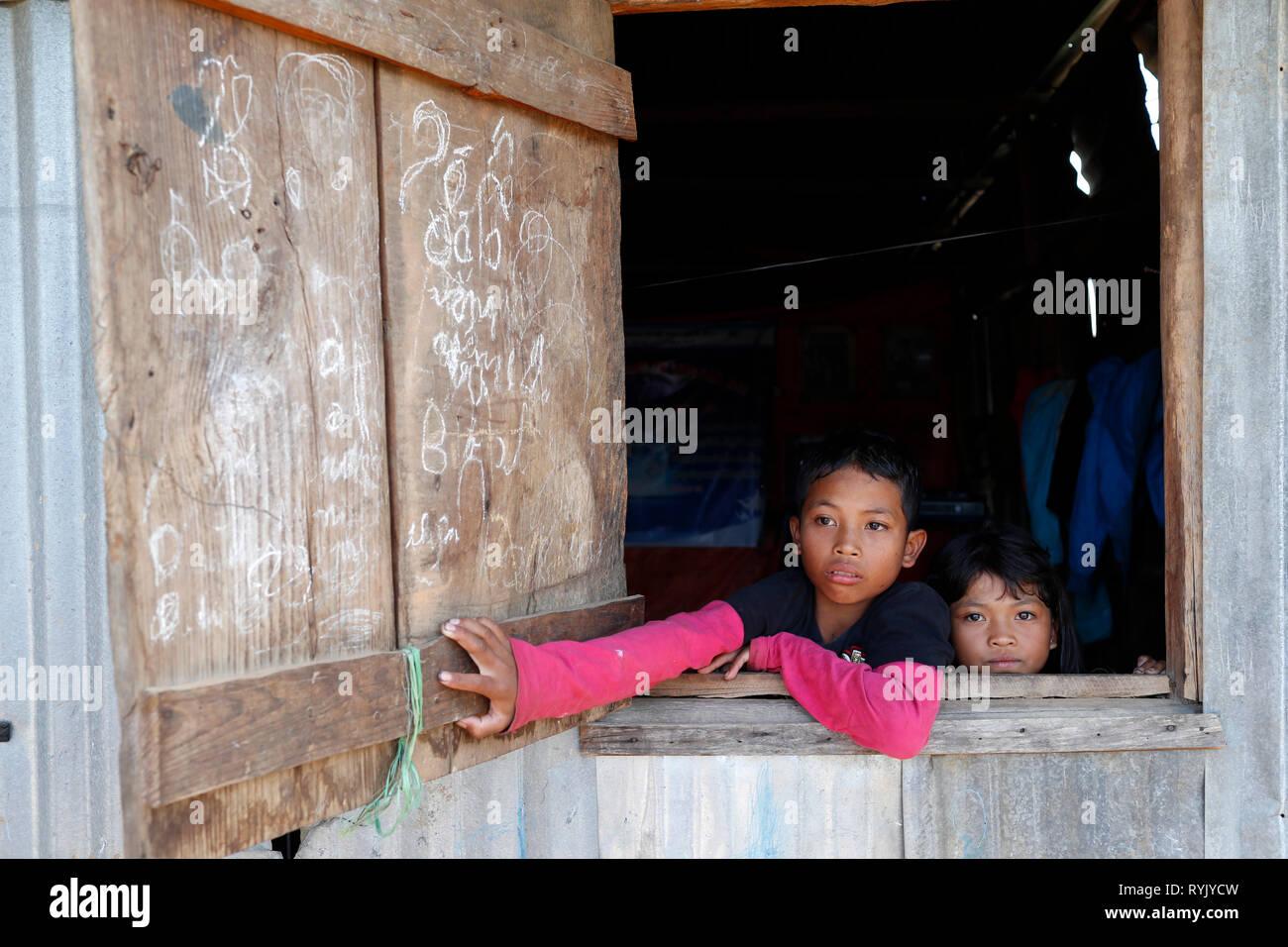 Poor vietnamese family living in a small barrack consists of scrap metal. Dalat. Vietnam. - Stock Image