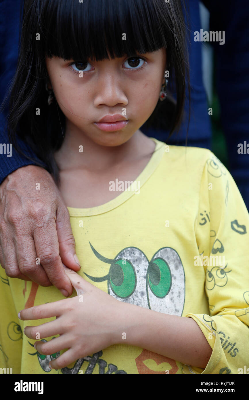 Free health clinic run by the Franciscan Missionaries of Mary.  Ethnic minority child with mother.  Dalat. Vietnam. Stock Photo