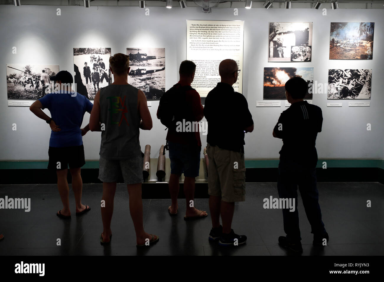 War Remnants Museum. Visitors looking at shocking photos from war.  Ho Chi Minh City. Vietnam. - Stock Image