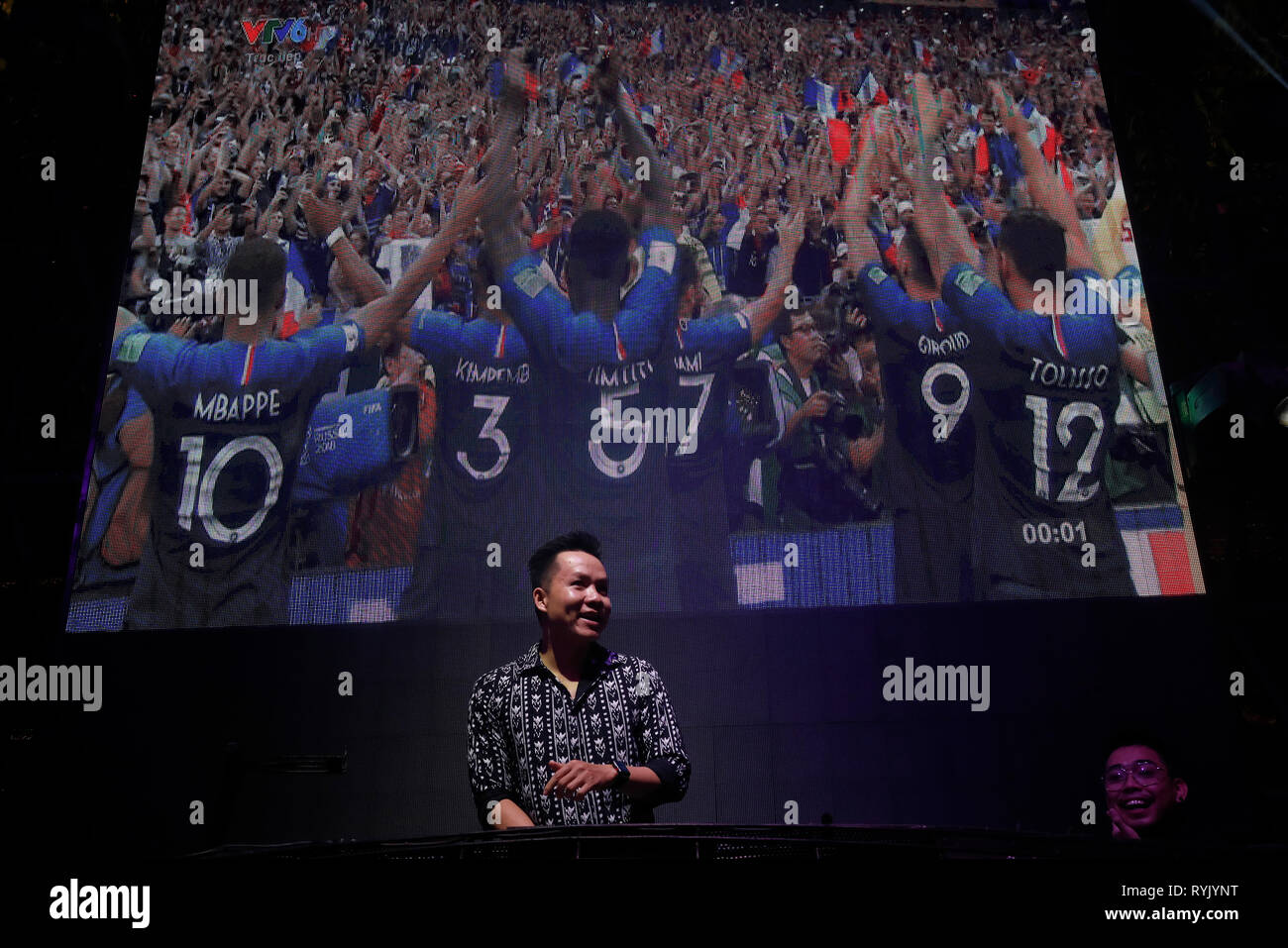 DJ on stage during FIFA  France vs Croatia 2018. France win World Football Cup 2018 final Ho Chi Minh City. Vietnam. - Stock Image