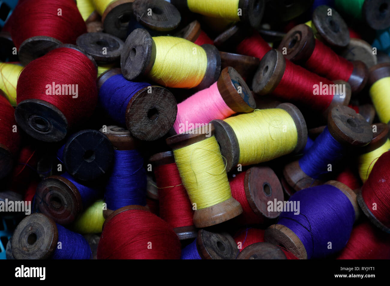 Close-up of multi-colored spools of thread.  Chau Doc. Vietnam. - Stock Image