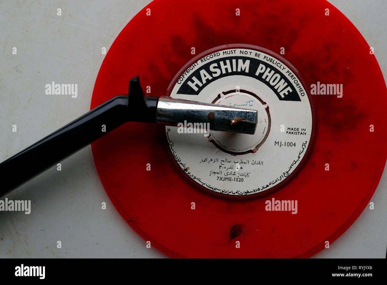 Red vinyl record on turntable.  Chau Doc. Vietnam. - Stock Image