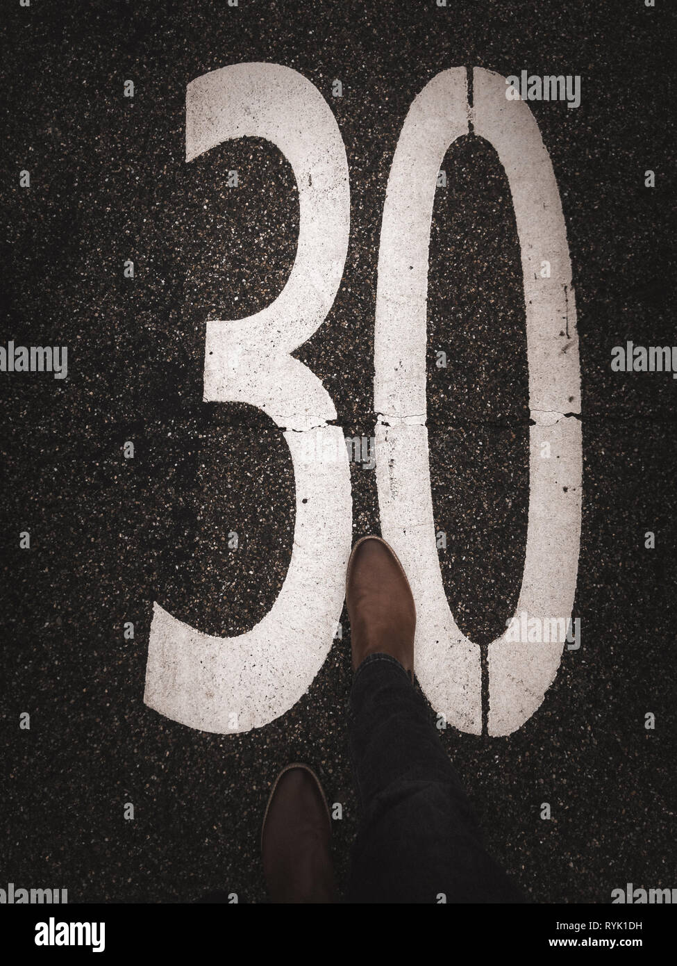 30 zone marking on pavement with leather shoe - Stock Image