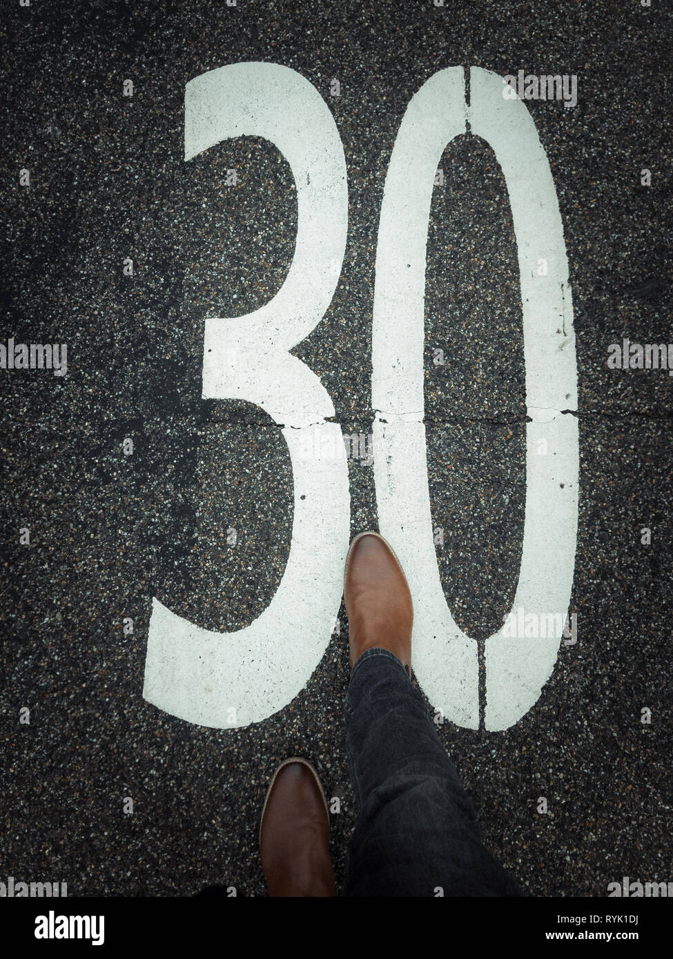 30 zone marking on pavement with leather shoe Stock Photo