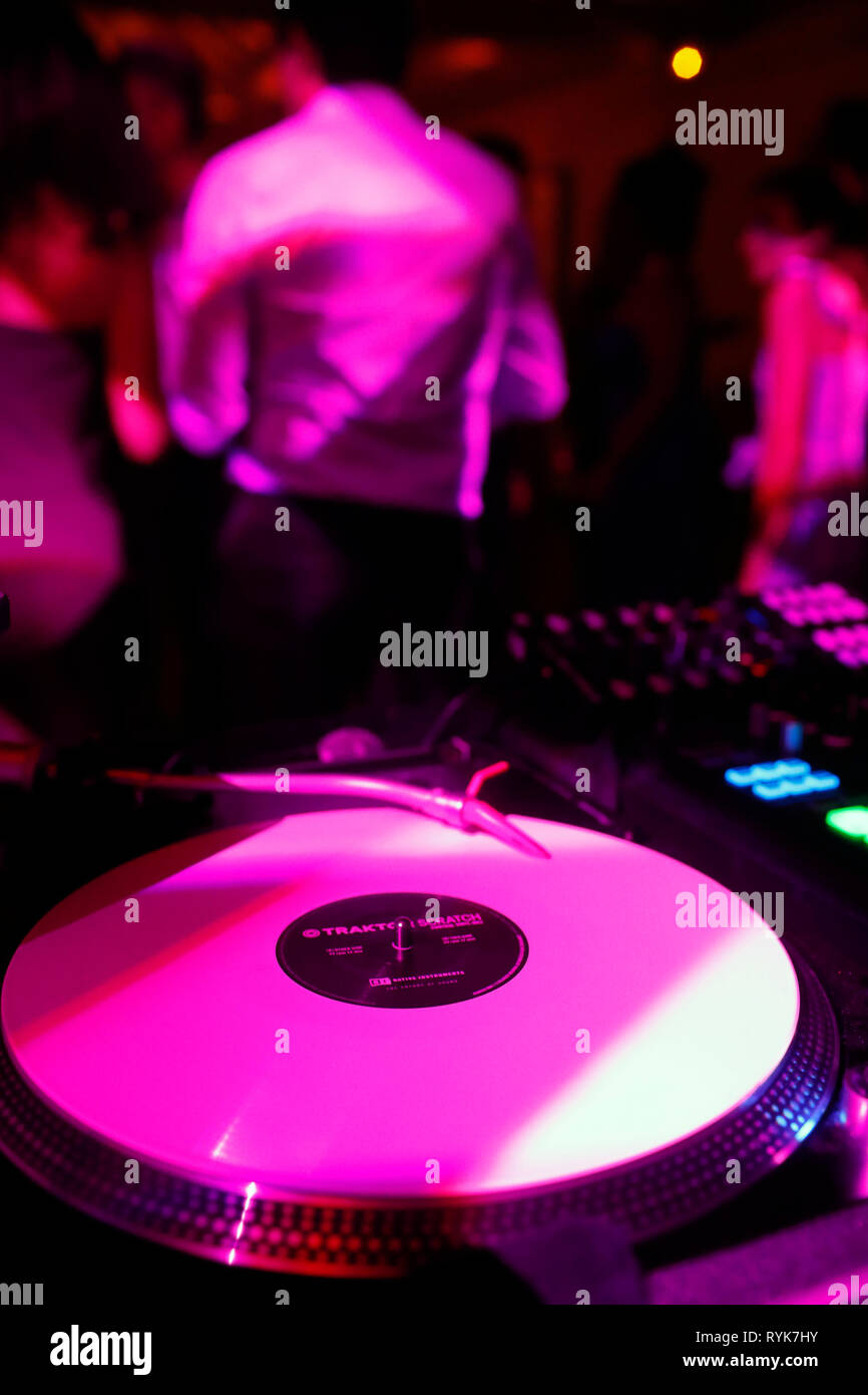 The DJ plays vinyl records for a wedding party. France. - Stock Image