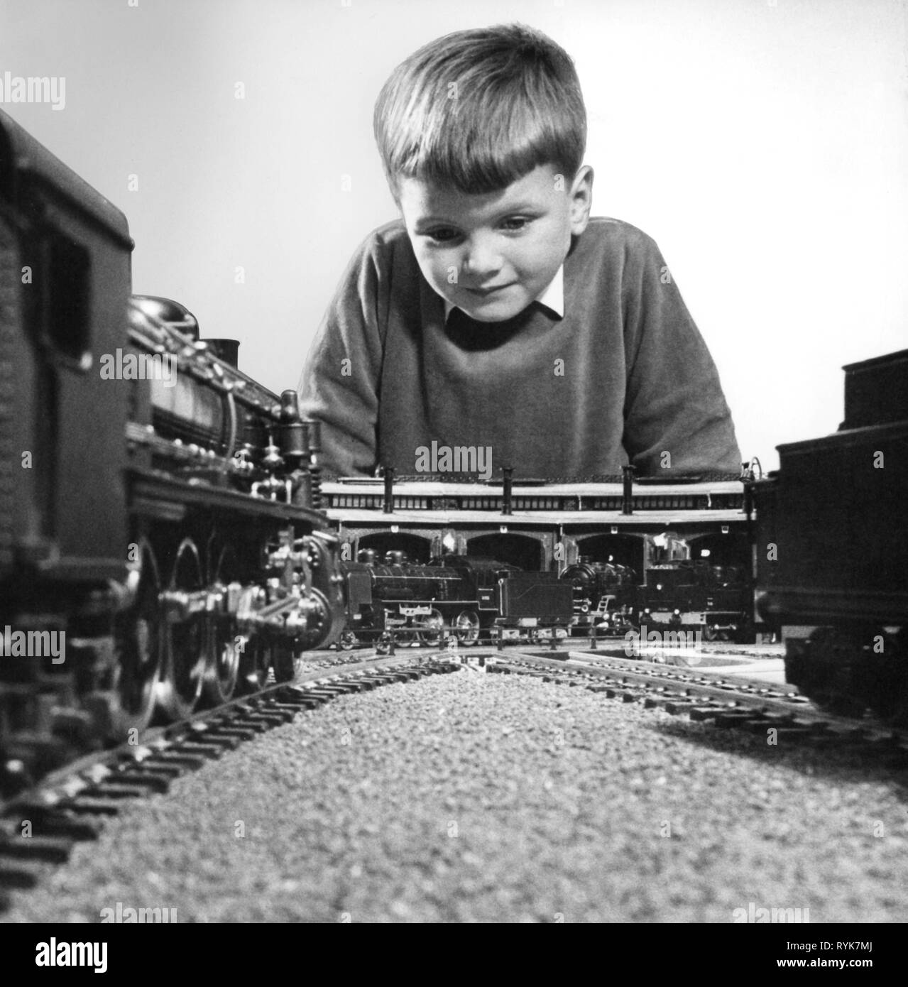 people, children, playing, a boy is playing with a version railway, Germany, 1960s, Additional-Rights-Clearance-Info-Not-Available Stock Photo