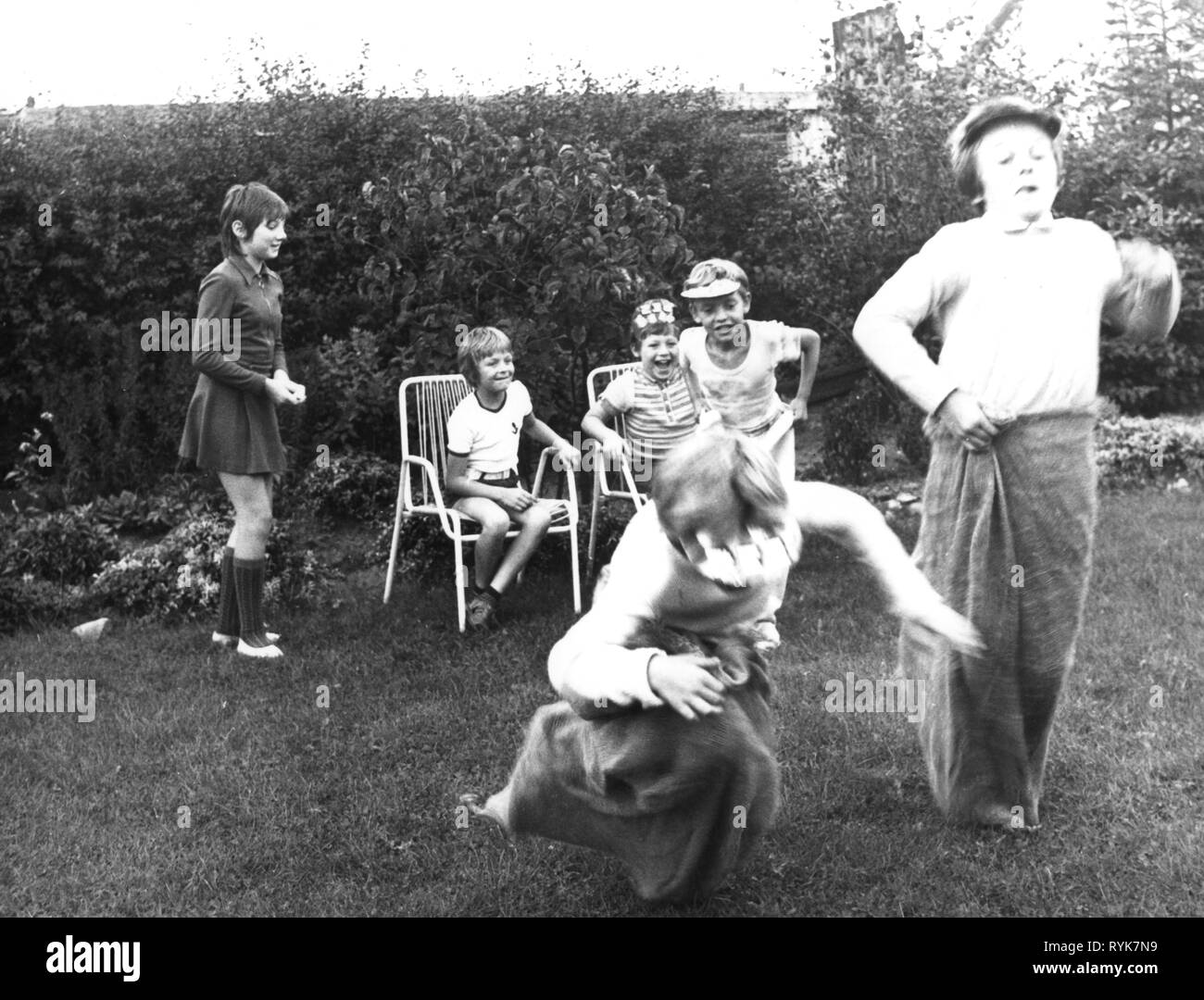 people, children, playing, group of children at sack race, Germany, 9.9.1972, Additional-Rights-Clearance-Info-Not-Available - Stock Image