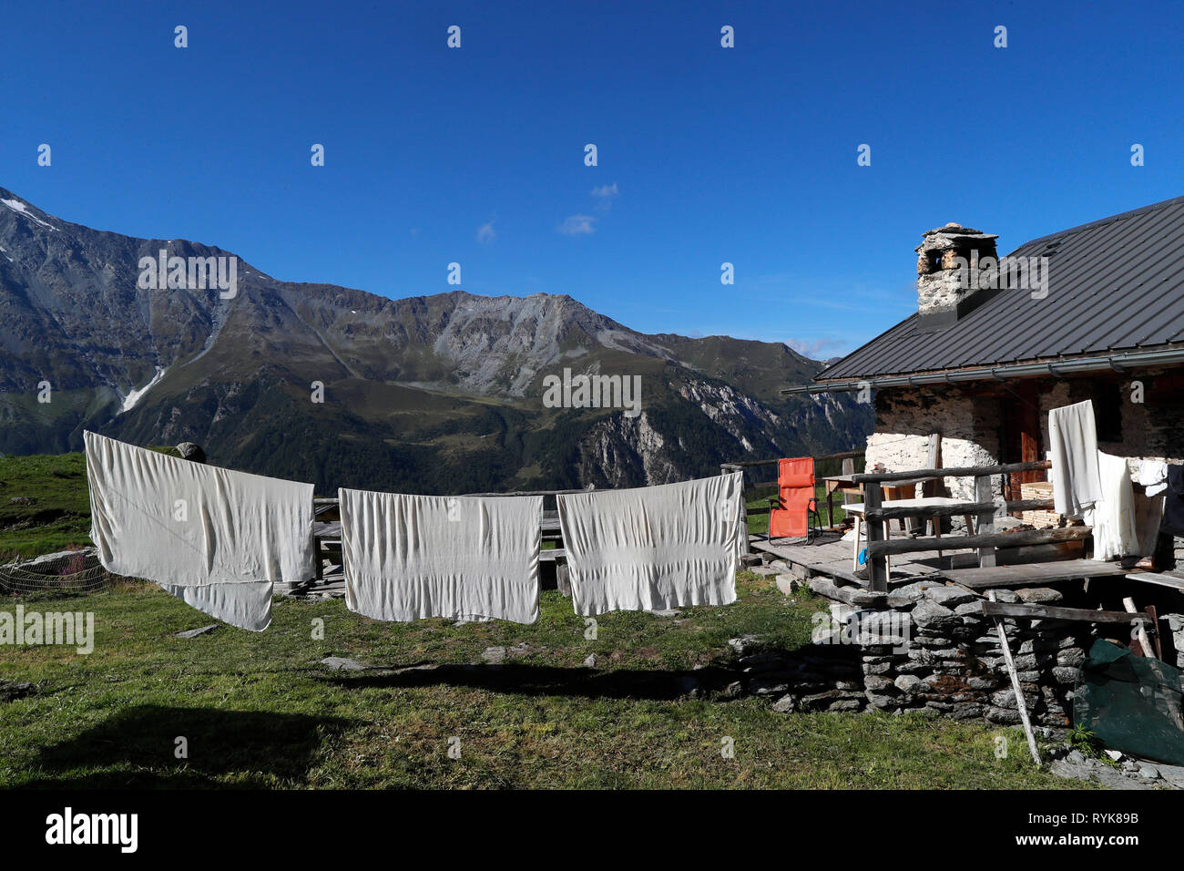 French Alps. Artisanal Beaufort cheese factory on high pastures.  Peisey Nancroix. France. - Stock Image