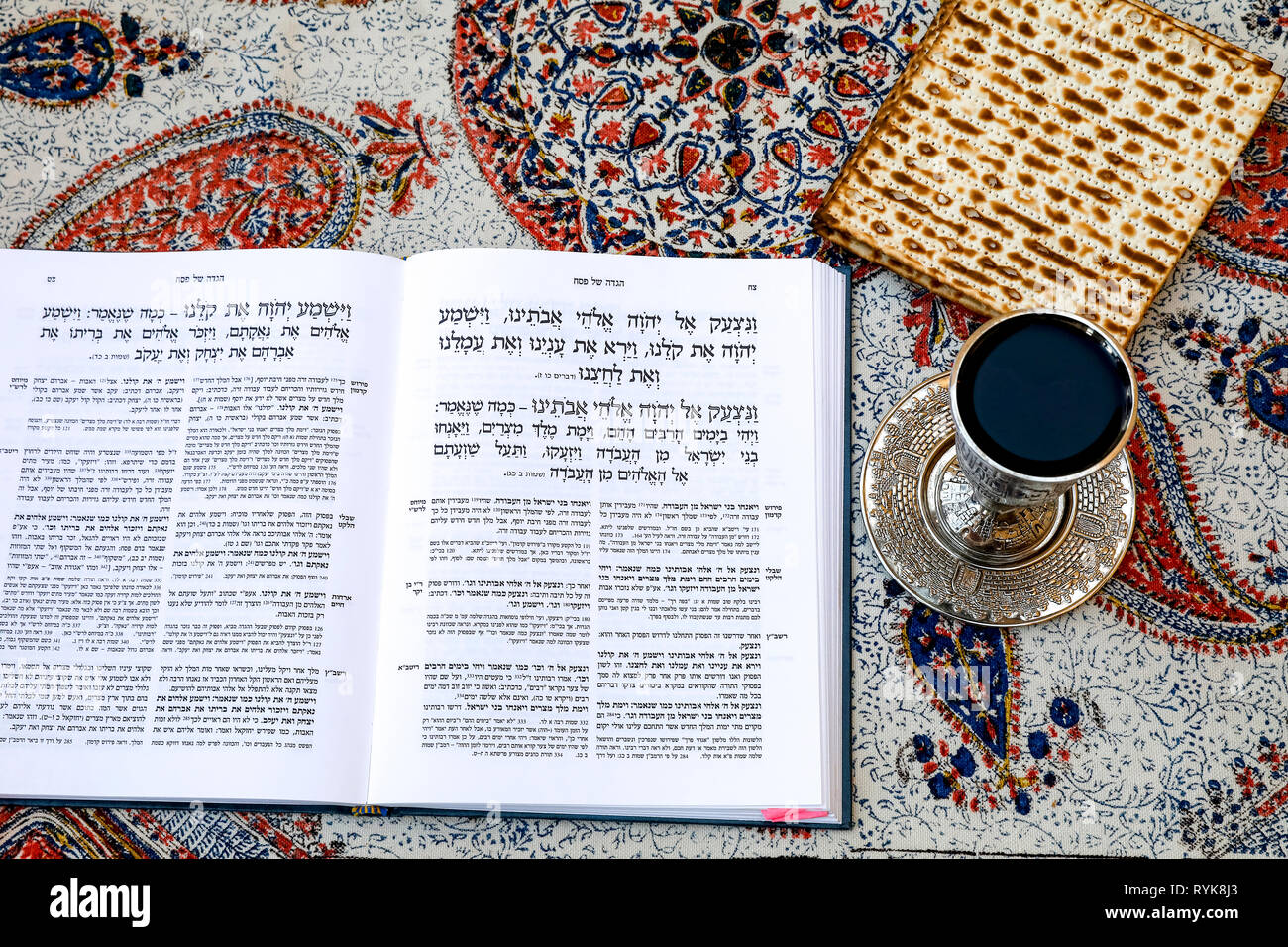 Passover Seder Haggadah in a Jerusalem jewish home, with wine and matsa. - Stock Image