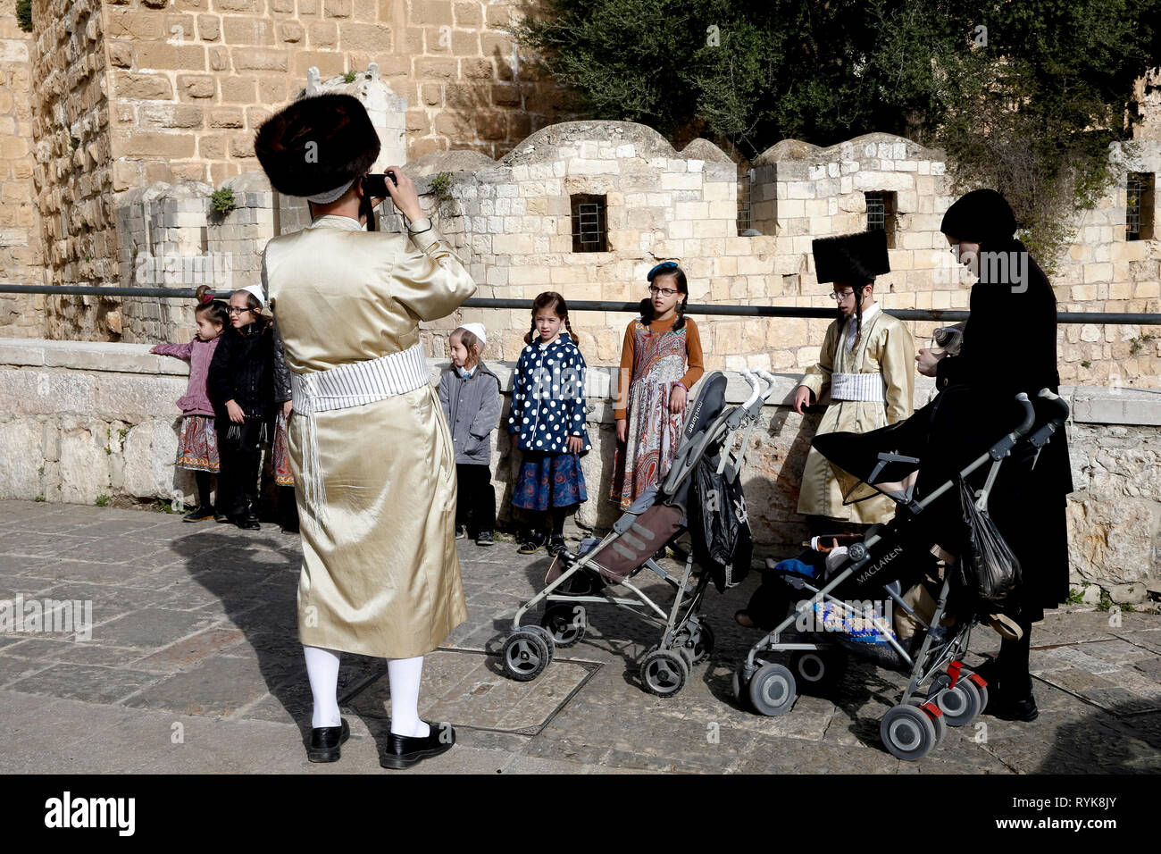 Orthodox Jew taking a family picture in the old city of Jerusalem, Israel. - Stock Image