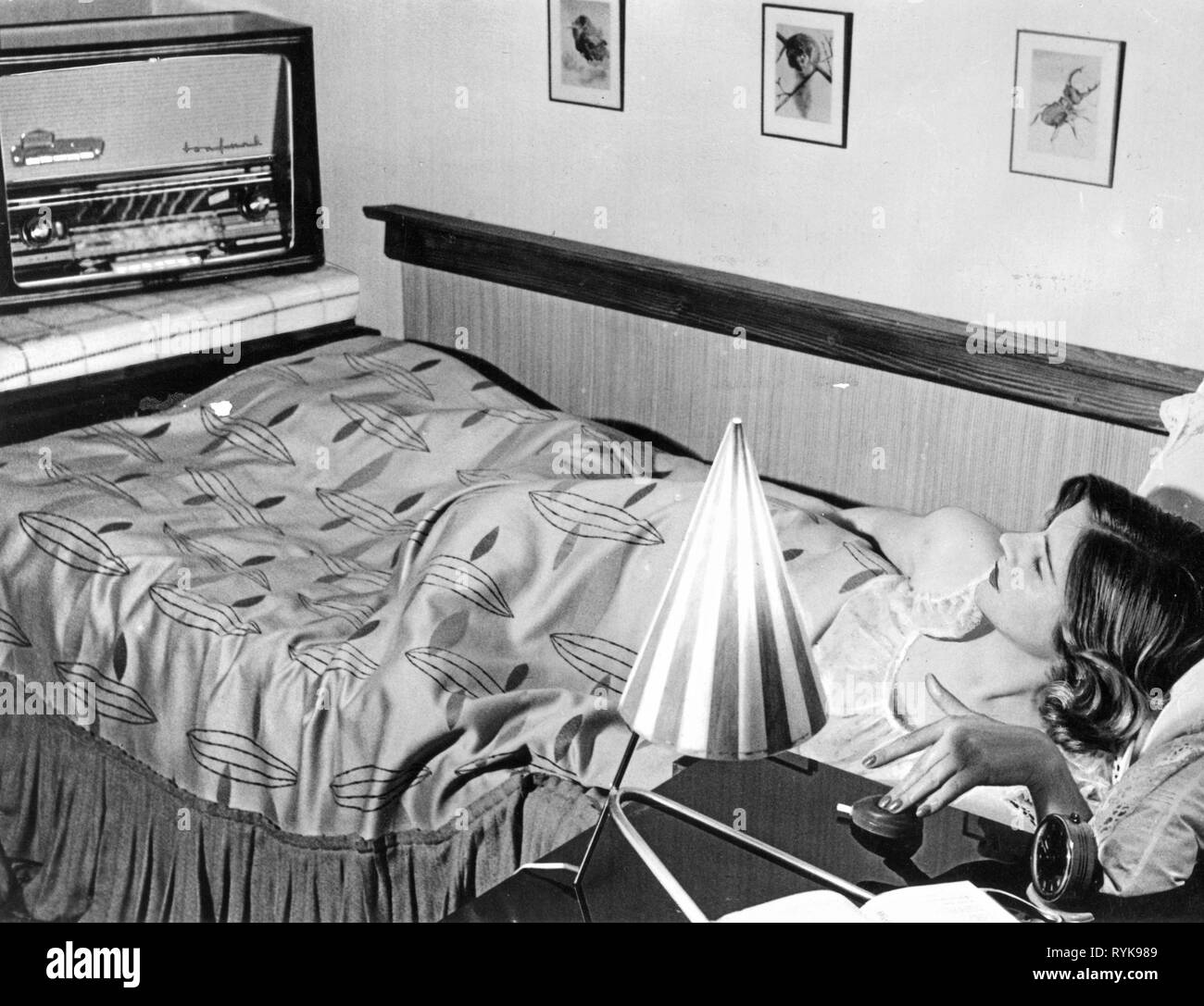 broadcast, radio, radio sets, Tonfunk Zauberperle W286F with 'magic switch', young woman lying in bed and operating the remote control, Germany, 1956, Additional-Rights-Clearance-Info-Not-Available - Stock Image