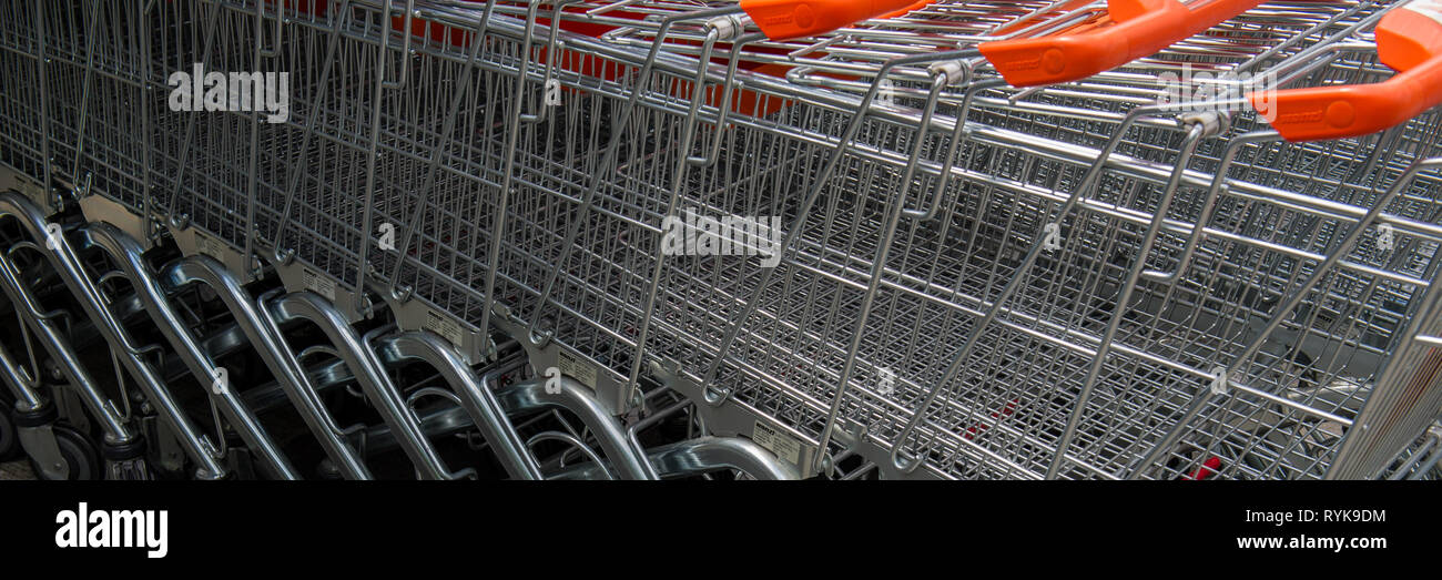 shopping baskets are near the supermarket. Web banner. - Stock Image