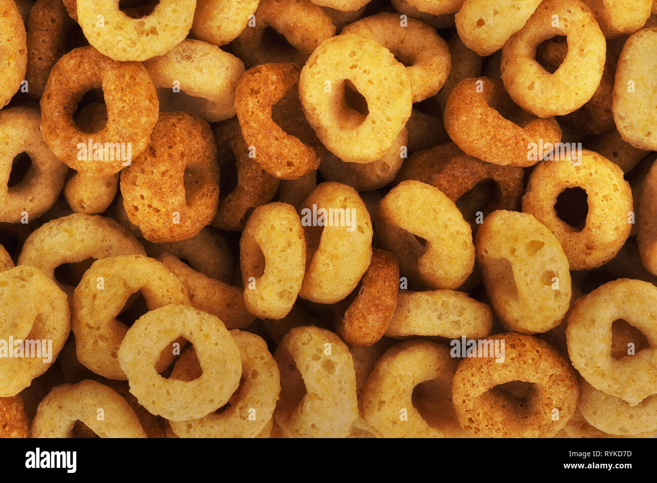 Extremely close up on cold cereals, quick breakfast for kids and adult, top view. - Stock Image