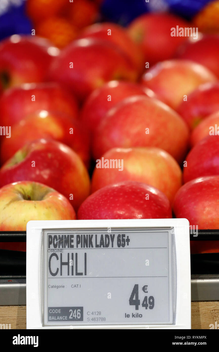 Importation fruits  for sale in supermarket. Apples from Chili.   France. - Stock Image