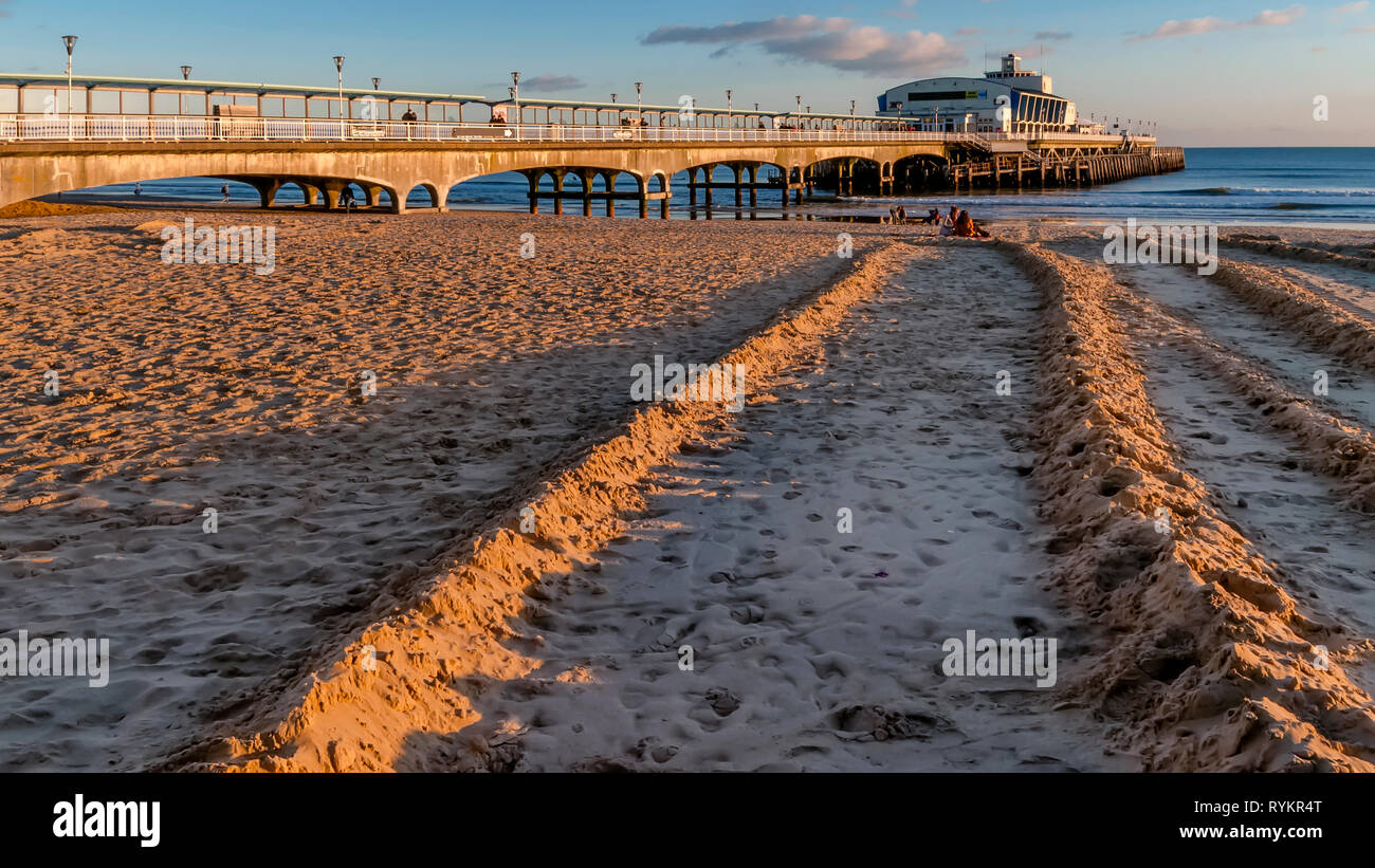 The pier and the sandy beach of Bournemouth in the light of a beautiful sunset, England Stock Photo