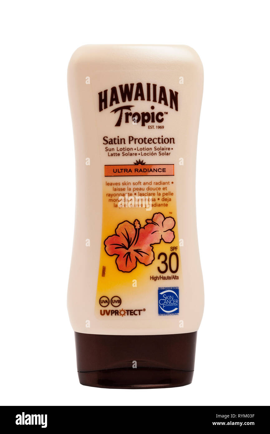 A tub of Hawaiian Tropic sun lotion cream with uv protection on a white background - Stock Image