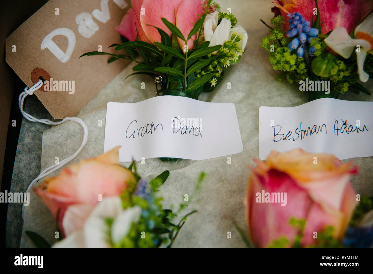 Men's wedding buttonhole flowers, colourful and rustic flowers. Buttonhole flower ideas - Stock Image