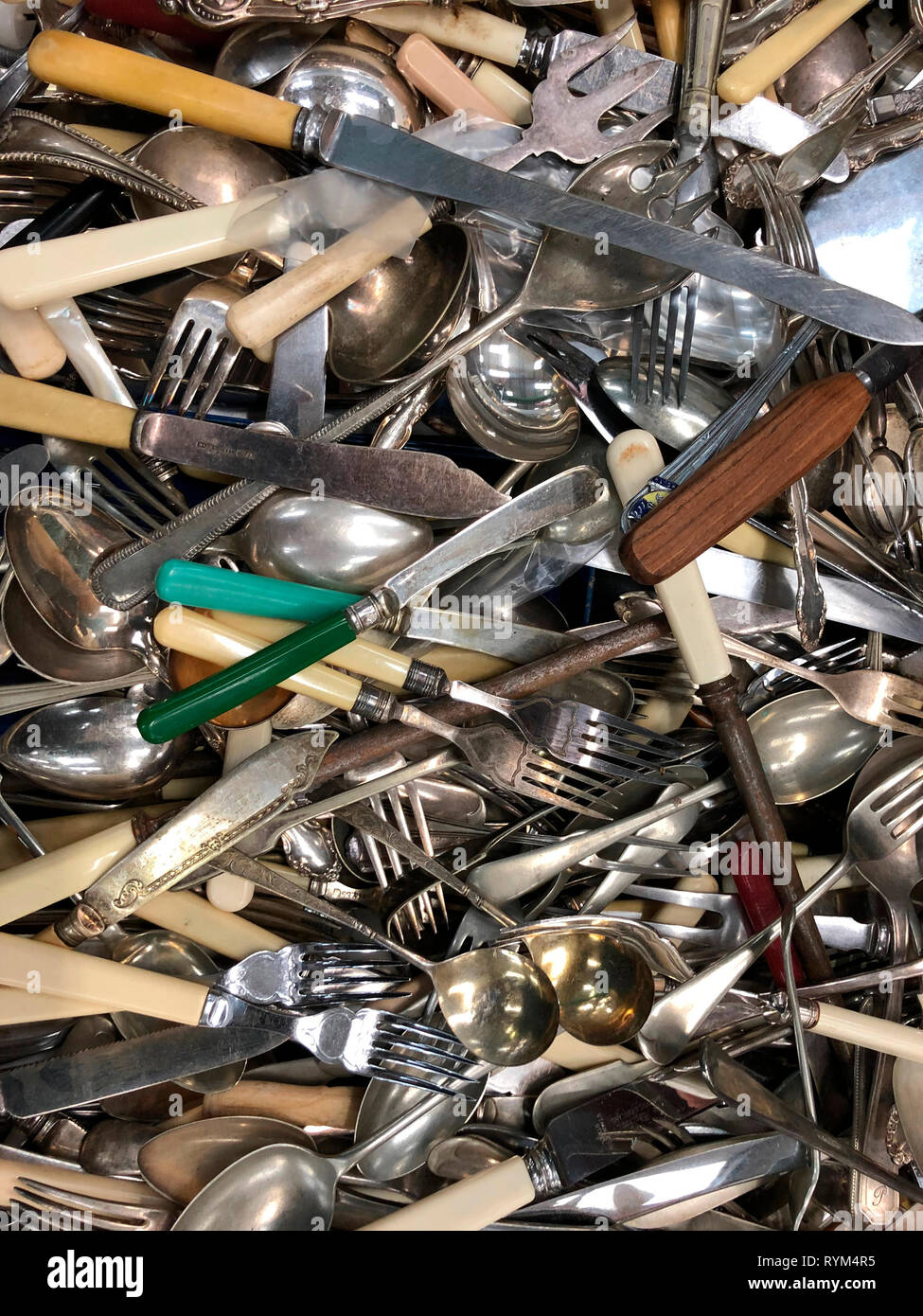 Pile of old cutlery - knives - forks - spoons Stock Photo