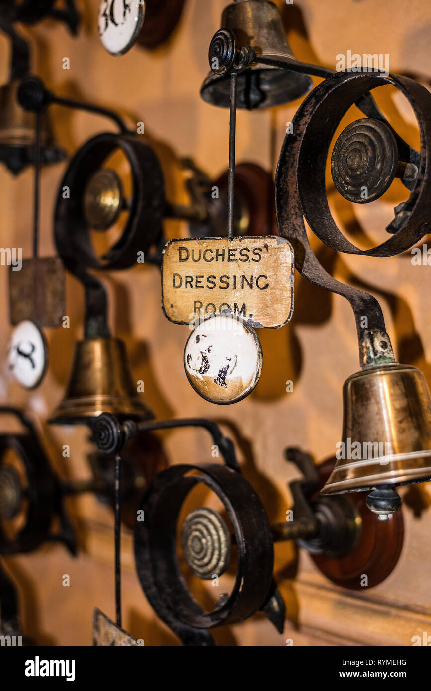 Label reading 'Duchess dressing room' on servant bell board in old country house, England - Stock Image