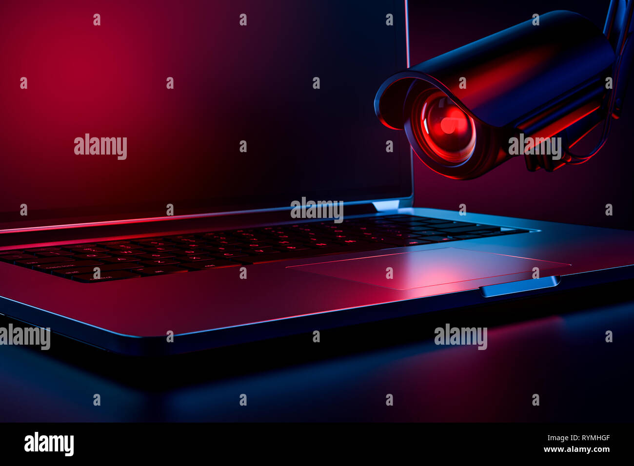 Computer observed by hostile looking camera as a metaphor of stalking or malicious software observing and tracking user. Copy space on the screen prov - Stock Image